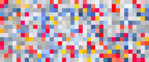 A large square image filled with pixelated colours ranging in colour. The colours are randomly placed, making each stand out next to the following image. The colours of the pixels are red, pink, orange, blue and white. The blues range in shades, starting with a dark blue and moving down into an almost white.