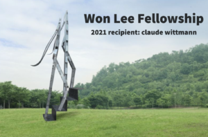 """The text """"Won Lee Fellowship: 2021 recipient: claude wittmann"""" is written on the top right corner, with the Tangled logo on the left corner. The text overlays an image of an art piece by Won Lee, a large-scale metal art piece of two abstracted figures walking up a set of steps. The sculpture stands on a field of green grass lined with trees."""